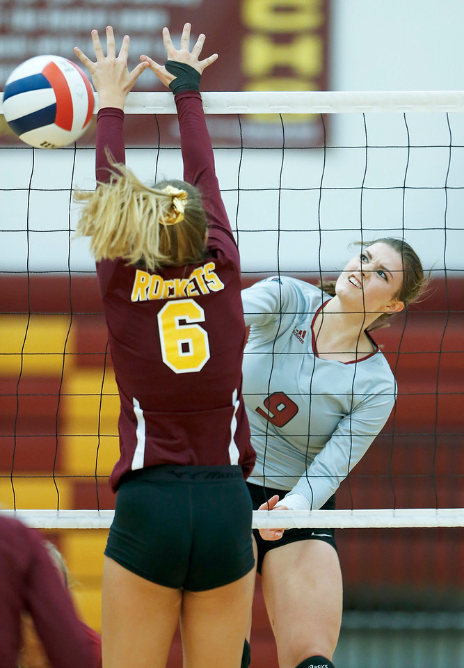 John Konstantaras - for Shaw Media Antioch's Breanne Kramer (9) scores past Bailey Dean (6) from Richmond-Burton during their second game on Monday, August 28, 2017 in Richmond. The Sequoits defeated the Rockets in 2 games; 15-25, 23-25.