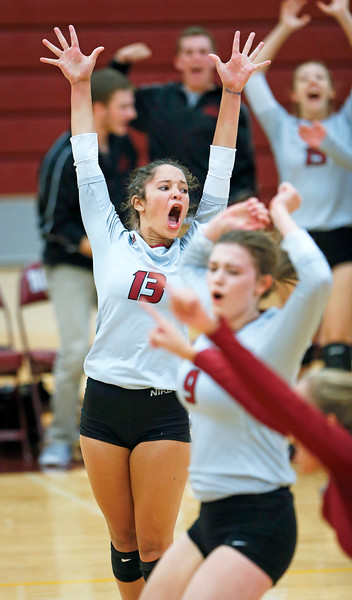 John Konstantaras - for Shaw Media Antioch's Cenie Frieson (13) celebrates game point in their second game against Richmond-Burton on Monday, August 28, 2017 in Richmond. The Sequoits defeated the Rockets in 2 games; 15-25, 23-25.