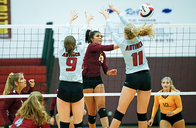John Konstantaras - for Shaw Media Richmond-Burton's Kayla Malec (12) from scores past Antioch's Breanne Kramer (9) and Kat Barr (11) during their first game on Monday, August 28, 2017 in Richmond. The Sequoits defeated the Rockets in 2 games; 15-25, 23-25.