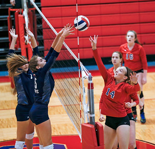 Tarrah Kamp (14) from Dundee-Crown battles at the net with Jenna Splitt (15) from Cary-Grove during the first game of their match at Dundee-Crown High School on Thursday, August 31, 2017 in Carpentersville, Illinois. The Trojans defeated the Chargers in 3 games; 25-20, 14-25, 16-25.  John Konstantaras photo for the Shaw Media