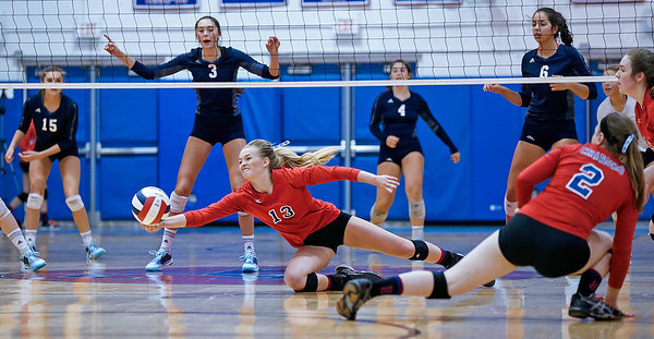Jenna Brown (13) from Dundee-Crown dives for a ball during the third game of their match against Cary-Grove at Dundee-Crown High School on Thursday, August 31, 2017 in Carpentersville, Illinois. The Trojans defeated the Chargers in 3 games; 25-20, 14-25, 16-25.  John Konstantaras photo for the Shaw Media
