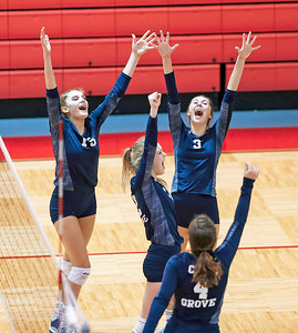 Jenna Splitt (15), Jen Apitz (12), Amber Olson (3) and Emily Schuster (4) from Cary-Grove celebrate game point during the third game of their match against Dundee-Crown on Thursday, August 31, 2017 in Carpentersville, Illinois. The Trojans defeated the Chargers in 3 games; 25-20, 14-25, 16-25.  John Konstantaras photo for the Shaw Media