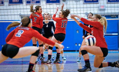 Amber Olson (3) from Cary-Grove watches her kill as the ball splits Carolyn Ptaszek (2) and Jenna Brown (13) from Dundee-Crown during the third game of their match at Dundee-Crown High School on Thursday, August 31, 2017 in Carpentersville, Illinois. The Trojans defeated the Chargers in 3 games; 25-20, 14-25, 16-25.  John Konstantaras photo for the Shaw Media
