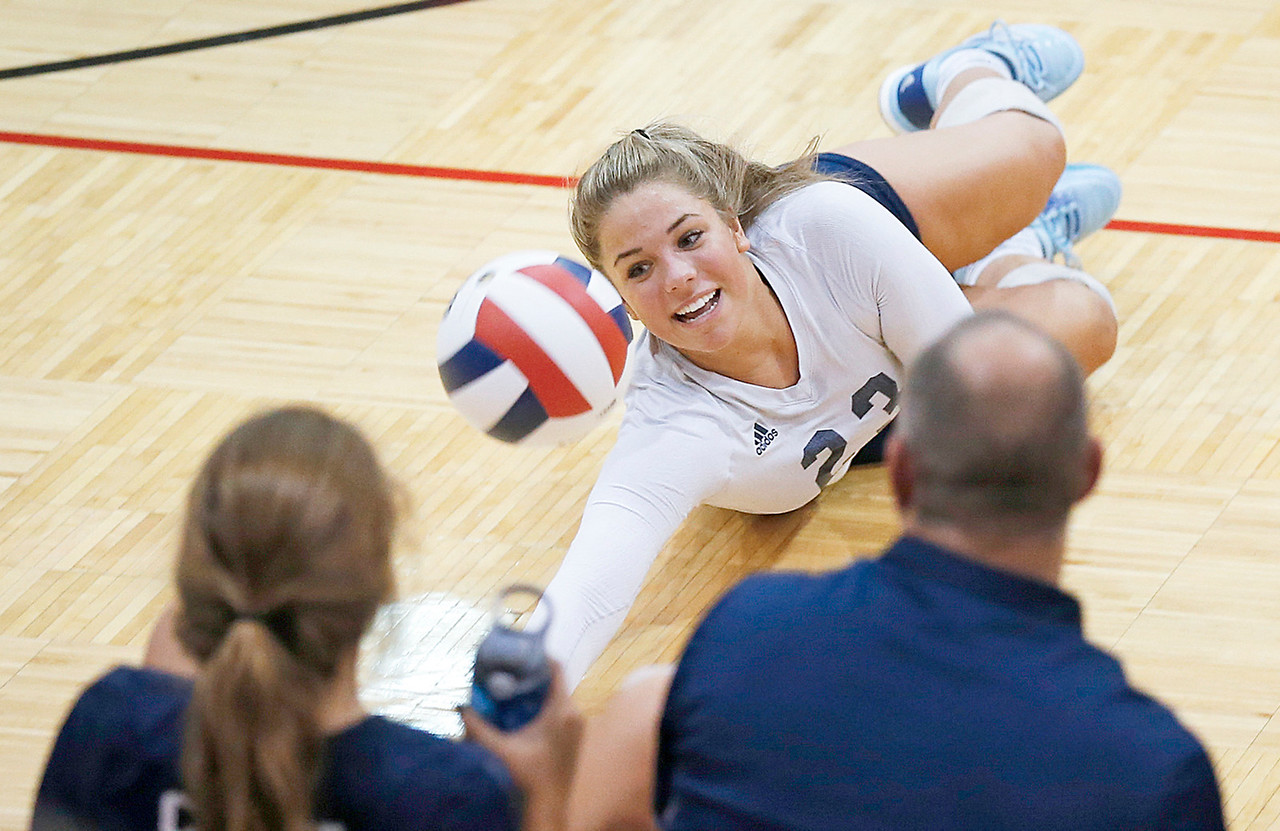 Kate Selsky (23) from Cary-Grove dives for a ball on the line during the first game of their match against Dundee-Crown on Thursday, August 31, 2017 in Carpentersville, Illinois. The Trojans defeated the Chargers in 3 games; 25-20, 14-25, 16-25.  John Konstantaras photo for the Shaw Media
