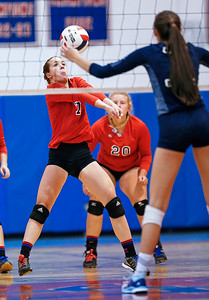 Jenna Thelen (7) from Dundee-Crown bumps a ball at the net during the second game of their match against Cary-Grove at Dundee-Crown High School on Thursday, August 31, 2017 in Carpentersville, Illinois. The Trojans defeated the Chargers in 3 games; 25-20, 14-25, 16-25.  John Konstantaras photo for the Shaw Media