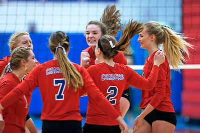Dundee-Crown players celebrate after winning their first game against Cary-Grove at Dundee-Crown High School on Thursday, August 31, 2017 in Carpentersville, Illinois. The Trojans defeated the Chargers in 3 games; 25-20, 14-25, 16-25.  John Konstantaras photo for the Shaw Media