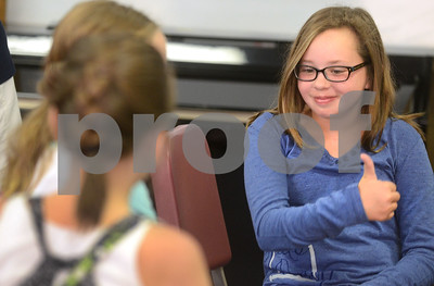 Ella Knickerbocker gives a thumbs-up as students break off into smaller groups to meet each other Aug. 14 during a sneak preview day for incoming seventh-graders at Herrick Middle School in Downers Grove. Mark Busch - mbusch@shawmedia.com