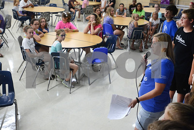 Julie Quinlan, eighth-grade school counselor, greets incoming students Aug. 14 during a sneak preview day for incoming seventh-graders at Herrick Middle School in Downers Grove. Mark Busch - mbusch@shawmedia.com
