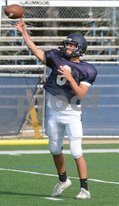 IC Catholic quarterback Luke Ricobene fires a pass during action Aug. 15 at practice at Plunkett Park in Elmhurst. Mark Busch - mbusch@shawmedia.com