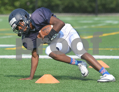 IC Catholic running back Lazerick Eatman rounds a cone during a drill Aug. 15 at practice at Plunkett Park in Elmhurst. Mark Busch - mbusch@shawmedia.com