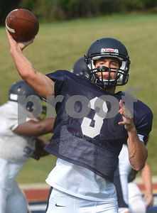 IC Catholic quarterback Luke Ricobene throws a pass Aug. 15 during practice at Plunkett Park in Elmhurst. Mark Busch - mbusch@shawmedia.com