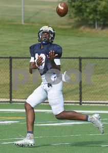 IC Catholic receiver Khali Saunders looks the ball in on a touchdown pass during 11 on 11 live action Aug. 15 during practice at Plunkett Park in Elmhurst. Mark Busch - mbusch@shawmedia.com