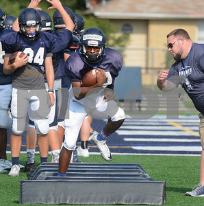 IC Catholic runningbacks including Lazerick Eatman (front) go through a drill Aug. 15 during practice at Plunkett Park in Elmhurst. Mark Busch - mbusch@shawmedia.com
