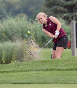 Richmond Burton High School's Darci Retherford hits from the sand at the Marian Central Girls Golf Invitational Thursday, August 9, 2018 held at the Boone Creek Golf Club in Bull Valley. KKoontz – For Shaw Media