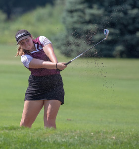 Prairie Ridge High School's Morgan Taylor plays from the sand at the Marian Central Girls Golf Invitational Thursday, August 9, 2018 held at the Boone Creek Golf Club in Bull Valley. KKoontz – For Shaw Media