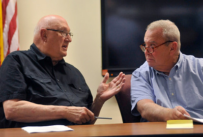 Gregory Shaver for Shaw Media Harvard Fire Protection District Board Trustees Jim Carbonetti and Thomas Condon talk about procedure during the public comment period of the Harvard Fire Protection District Board of Trustees meeting Tuesday evening Aug. 14, 2018, at Harvard Fire Station, 502 S. Eastman St., Harvard.