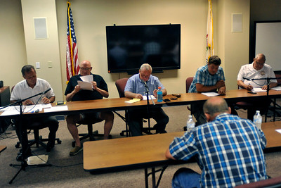 Gregory Shaver for Shaw Media Harvard Fire Protection District Board of Trustees members vote to go into closed session during a meeting of the Harvard Fire Protection District Board of Trustees Tuesday evening Aug. 14, 2018, at Harvard Fire Station, 502 S. Eastman St., Harvard.