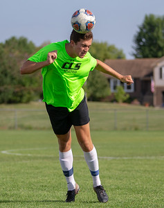 Crystal Lake South senior Nicholas Langdon redirects the ball during practice Thursday, August 16, 2018 in Crystal Lake.  KKoontz- For Shaw Media