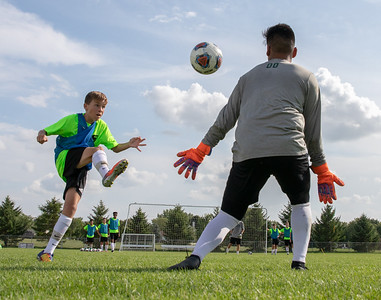 Thomas Coughlin lifts the ball over goaltender Oscar Estrada Thursday, August 16, 2018 in Crystal Lake. KKoontz – For Shaw Media
