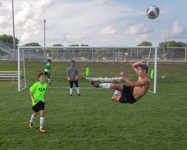 Crystal Lake South's Alexander Canfield kicks the ball while flying through the air during a practice drill Thursday, August 16, 2018 in Crystal Lake. Canfield, a junior, was last year's leading scorer with 12 goals. KKoontz – For Shaw Media