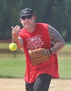 "Candace H. Johnson-For Shaw Media Gurnee Fire's Bob Davidson pitches against a player from Gurnee Police during the Gurnee Days ""Battle of the Badges"" softball game at Viking Park in Gurnee. Gurnee Fire won 19-9. (8/12/18)"