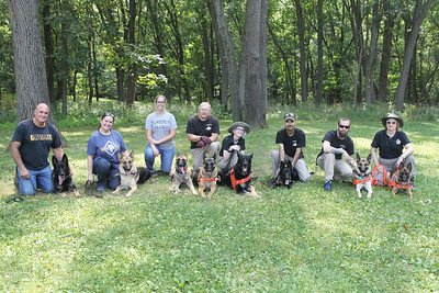 Candace H. Johnson-For Shaw Media K-9 dog handlers take a group shot after the Disaster Dogs of Illinois training at the Lakewood Forest Preserve in Wauconda. (8/12/18)