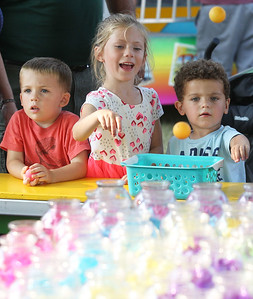 Candace H. Johnson-For Shaw Media Mason Fuchs, 3, of Trevor, Wis., his sister, Emma, 6, and their cousin, Levi, 2, of Antioch play the Goldfish game during Lindenfest at Slove Park in Lindenhurst. (8/11/18)