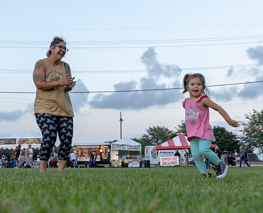 Natalie and 2 year old daughter Mackenzie Phelps from McHenry dance to the blues during the annual Blues, Brews, and BBQ Friday, August 17, 2018 at Peterson Park in McHenry. KKoontz – For Shaw Media