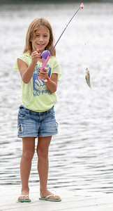 Ellie Heick (8 yrs) from Barrington catches a fish at the second annual Conner Kincaid Memorial Fishing Tournament held at Indian Trail Beach in Lake in the Hills Saturday, August 18, 2018. KKoontz – For Shaw Media
