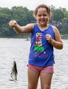 "Ava Embury (7yrs) shows off her 12"" channel catfish caught during the second annual Conner Kincaid Memorial Fishing Tournament held at Indian Trail Beach in Lake in the Hills Saturday, August 18, 2018. KKoontz – For Shaw Media"