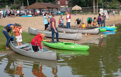 Area residents prepare their boats and await the start of the second annual Conner Kincaid Memorial Fishing Tournament held at Indian Trail Beach in Lake in the Hills Saturday, August 18, 2018. KKoontz – For Shaw Media