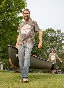 Scott Sinnett and Aaron Ryan from Algonquin take their canoe to the water at the second annual Conner Kincaid Memorial Fishing Tournament held at Indian Trail Beach in Lake in the Hills Saturday, August 18, 2018. KKoontz – For Shaw Media