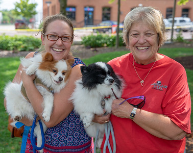 Courtney Reinhard and Sally Sullivan hold up their dogs, Dexter and Rusty, Sunday, August 19, 2018 at the 4th annual Bark-a-Paw-Looza held at the Woodstock Square.  Both of the dogs were adopted as rescues. KKoontz – for Shaw Media