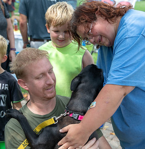 Doug Walter and Laura Hodges from Wonder Lake play with puppies that are up for adoption Sunday, August 19, 2018 at the 4th annual Bark-a-Paw-Looza held at the Woodstock Square.   KKoontz – for Shaw Media