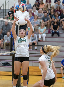 Crystal Lake South's McKenzie Wilson sets the ball for a teammate Tuesday, August 21, 2018 in Prairie Grove. South played hard but fell to Prairie Ridge in the season opener 25-17 and 25-15. KKoontz – For Shaw Media