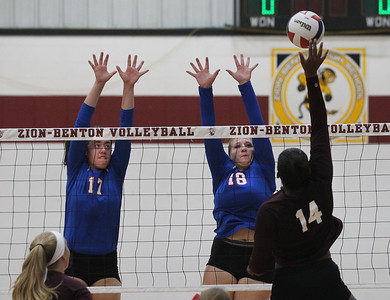 Candace H. Johnson-For Shaw Media Lakes Keelan Bell and Kelli Rettig go up for a block against Zion-Benton's Kennedy Collins in the first game at Zion-Benton Township High School in Zion. Lakes won 25-16, 25-13. (8/20/18)