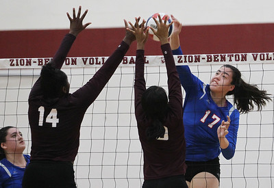 Candace H. Johnson-For Shaw Media Lakes Keelan Bell (#17) gets past the block by Zion-Benton's Kennedy Collins and Nia Delaney in the first game at Zion-Benton Township High School in Zion. Lakes won 25-16, 25-13. (8/20/18)