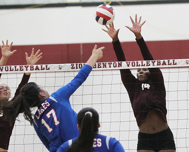 Candace H. Johnson-For Shaw Media Lakes Keelan Bell makes an attack against Zion-Benton's Kennedy Collins in the second game at Zion-Benton Township High School in Zion. Lakes won 25-16, 25-13. (8/20/18)