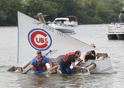 "Candace H. Johnson-For Shaw Media The ""Try Not to Suck"" boat with a Cubs theme and its crew members start to sink during the 21st annual Cardboard Boat Race at Lakefront Park in Fox Lake. (8/19/18)"