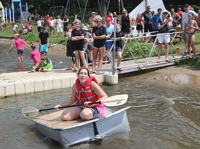 "Candace H. Johnson-For Shaw Media Ashley Walker, of Chicago, in her boat called, ""Shark's Bait,"" gets stuck in the water as she competes in one of the boat races during the 21st annual Cardboard Boat Race at Lakefront Park in Fox Lake. (8/19/18)"