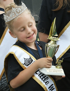 Candace H. Johnson-For Shaw Media Little Miss Fox Lake 2018 Athena Schmitz, 6, sees her reflection as she holds one of the winning trophies to be given out during the 21st annual Cardboard Boat Race at Lakefront Park in Fox Lake. (8/19/18)