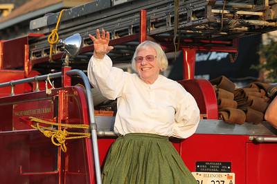 Candace H. Johnson-For Shaw Media Charlotte Renehan, Grayslake Historical Society and Museum volunteer, waves to the crowd as she rides a 1954 fire truck, made in Grayslake, during the Grayslake Summer Days Parade. (8/18/18)
