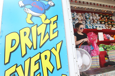 Candace H. Johnson-For Shaw Media Kathie Lipps, of Chicago with Kasin Concessions inflates a gummy bear prize for the Duck Pond game during Grayslake Summer Days in downtown Grayslake. The event was sponsored by the Grayslake Chamber of Commerce & Industry. (8/18/18)