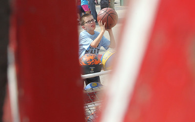 Candace H. Johnson-For Shaw Media Luke Valosky, 10, of Grayslake shoots hoops to win a prize during Grayslake Summer Days in downtown Grayslake. The event was sponsored by the Grayslake Chamber of Commerce & Industry. (8/18/18)