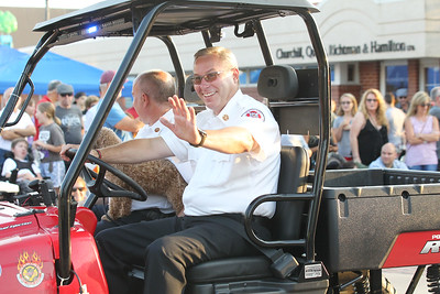 Candace H. Johnson-For Shaw Media Grayslake Fire Chief John Christian waves to the crowd during the Grayslake Summer Days Parade on Center Street. (8/18/18)