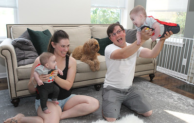 Candace H. Johnson-For Shaw Media Kimberly and Jeremiah Husko have fun with their twins Ariella and Amara, both five-months-old, in their Wonder Woman outfits as their dog, Moose, sits close by at their home in Grayslake.The Husko's also have a son, Micah, 2. (8/18/18)