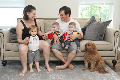 Candace H. Johnson-For Shaw Media Kimberly and Jeremiah Husko with their children, Micah, 2, twins Ariella and Amara, five-months-old, and their dog, Moose, at their home in Grayslake. (8/18/18)
