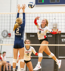 Huntley senior Loren Alberts (R) redirects the ball over the net Thursday, August 23, 2018 in Cary. Huntley took the victory over Cary-Grove in three sets.  KKoontz – For Shaw Media
