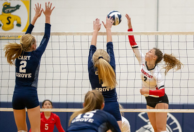 Huntley's Julia Johnson drives one over the net Thursday, August 23, 2018 in Cary. Johnson finished with 14 kills in Huntley's three set victory over Cary-Grove. KKoontz – For Shaw Media