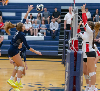 Cary-Grove sophomore Jenna Splitt goes up against a solid Huntley defense Thursday, August 23, 2018 in Cary. Huntley took the win in three sets.  KKoontz – For Shaw Media